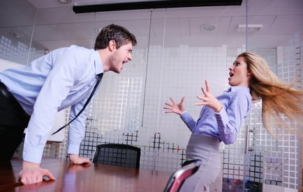 Angry businessman screaming at employee